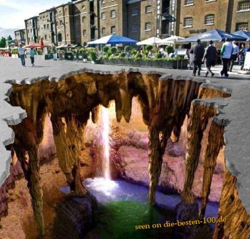 Die besten 100 Bilder in der Kategorie strassenmalerei: Riesen-Höhle unter Straße - Streetart