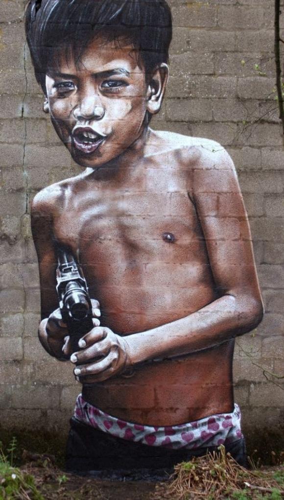 Die besten 100 Bilder in der Kategorie graffiti: Photorealistisches Grafitti - Junge mit Maschinengewehr