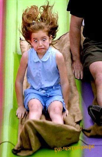 Die besten 100 Bilder in der Kategorie kinder: Lustiger Gesichtsausdruck beim Rutschen