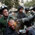 Die besten Bilder in der Kategorie Vote: Israeli border police officers use pepper spray as they detain an injured Palestinian protester during clashes on Land Day in March