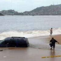 Bad Place for Parking - Car engulfs in Beach